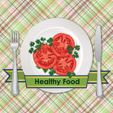 Healthy food sign. Tomato on plate over seamless checkered tablecloth pattern Royalty Free Stock Photos