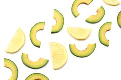 Healthy food. sliced avocado with lemon isolated on white background. top view Royalty Free Stock Photos