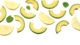 Healthy food. sliced avocado with lemon isolated on white background. top view Stock Photos
