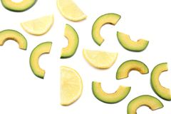 Healthy food. sliced avocado with lemon isolated on white background. top view Stock Photography
