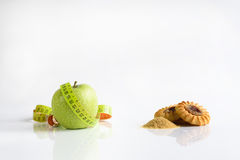 Healthy food with soft meter or harmful food. Healthy food or harmful food. your choice Stock Photos