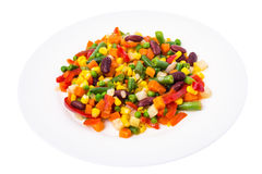Healthy food: steamed vegetables on a white plate stock photo