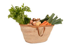 Healthy food: straw basket full of vegetables Royalty Free Stock Photography