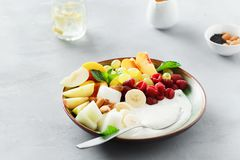 Healthy food table fruit breakfast natural yoghurt bowl. Healthy and dietary food concept, side view. Fruit breakfast and natural yoghurt bowl. Grapes, peach stock image