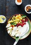 Healthy food table top view fruit breakfast natural yoghurt bowl. Healthy food concept on dark table, top view. Fruit breakfast and natural yoghurt bowl flat lay stock photo