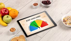 Healthy food with tablet on a wooden background Royalty Free Stock Image