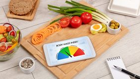 Healthy food with tablet on a wooden background Royalty Free Stock Photos