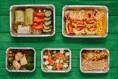 Healthy food take away in boxes, top view at green wood royalty free stock photo