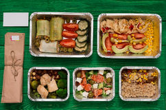 Healthy food take away in boxes, top view at green wood stock photography
