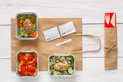 Healthy food take away in boxes, top view at wood Stock Images