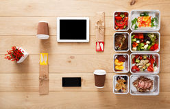 Healthy food take away in boxes, top view at wood Royalty Free Stock Photography