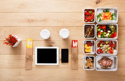 Healthy food take away in boxes, top view at wood Stock Photos