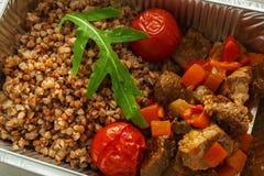 Healthy food take away in foil box, russian buckwheat kasha Stock Images