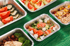 Healthy food take away in lunch boxes at green wood royalty free stock photo