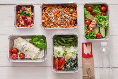 Healthy food take away, top view at wood background Stock Photos