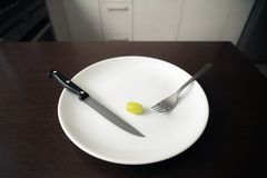 Healthy food theme: green grape on a white plate. loosing weight, healthy lifestyle stock images