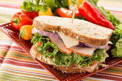 Healthy Food Turkey Ham Sandwich With Sweet Peppers. Healthy lunch food sandwich with turkey and ham on a plate with sweet peppers and lettuce Stock Photo