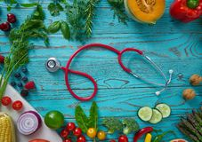 Healthy food vegetables for heart heath on wood. En turquoise background stock photos