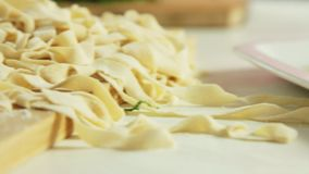 Healthy food in the kitchen. Healthy food with vegetables and home made pasta recipe in the kitchen closeup stock video footage