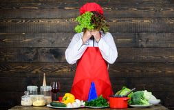 Healthy food and vegetarian. Professional chef in cook uniform. Dieting with organic food. Fresh vegetables. Vitamin royalty free stock image