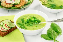 Healthy food vegetarian soup with asparagus and spinach, green peas and bread with vegetables. royalty free stock photography