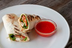 Healthy diet. Vegetarian wrap with tofu, hummus and hot sauce. P royalty free stock photos