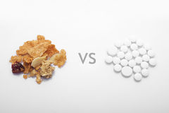 Healthy food versus drug Royalty Free Stock Images