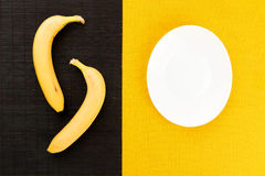 Healthy food and vitamins: several yellow ripe bananas lie on a Stock Images