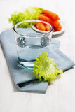 Healthy food - water, carrot and lettuce Stock Photography