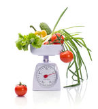 Healthy food on weights. Bright fresh Vegetables on weights isolated on white Stock Images
