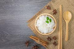 Healthy food, White rice, cooked white rice, cooked plain rice in wooden bowl with cinnamon and star anise, spoon and chopsticks, royalty free stock photo