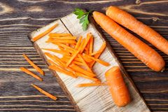 Healthy food - whole and sliced carrot royalty free stock images