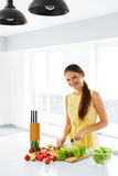 Healthy Food. Woman Cutting Vegetables. Salad, Food Preparation. Royalty Free Stock Photo
