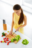 Healthy Food. Woman Cutting Vegetables. Salad, Food Preparation. Royalty Free Stock Photography