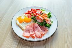 Healthy food on wood plate. Keto diet food concept. stock photos