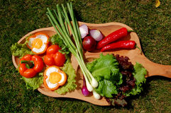 Healthy foods. Fried eggs and fresh vegetable on a plato Royalty Free Stock Image