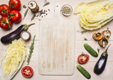 Healthy foods, cooking and vegetarian concept different vegetables and ingredients for the salad, lined around white cutting b. Healthy foods, cooking and stock photography