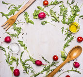 Healthy foods, cooking and vegetarian concept salad with cherry tomatoes, radishes, spices and wooden spoon and place for text Stock Image