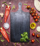 Healthy foods, cooking vegetarian concept variety of vegetables and fruits are laid out around the cutting board, place for te Royalty Free Stock Photo