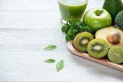 Healthy foods. Green smoothie for detox, diet, superfoods. Green apple, lemon, kiwi, cucumber, avocado and green leaves. stock photo