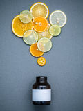 Healthy foods and medicine concept. Bottle of vitamin C and vari Royalty Free Stock Photo