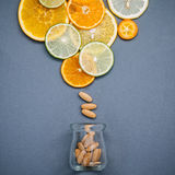 Healthy foods and medicine concept. Bottle of vitamin C and vari Stock Image