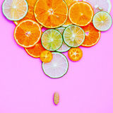 Healthy foods and medicine concept. Pill of vitamin C and variou Stock Photography