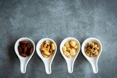 Healthy Foods. Mixed nuts in white bowls with nuts for diet on a concrete table. Different kinds of tasty and healthy nuts. Top vi. Ew and copy space. Healthy royalty free stock images