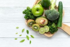 Healthy Foods. Organic and Fresh green vegetable for detox, diet and weight loss on the white wooden. stock image
