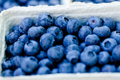 Healthy fresh blueberries macro closeup on market outdoor Stock Photo