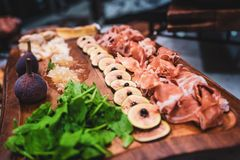 Healthy and fresh charcuterie board with fruits and meats. stock image