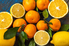 Healthy fresh citrus juice two glasses, oranges, tangerines, lemons, ice, leaves. Royalty Free Stock Photography