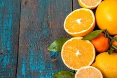 Healthy fresh citrus juice two glasses, oranges, tangerines, lemons, ice, leaves. Stock Images