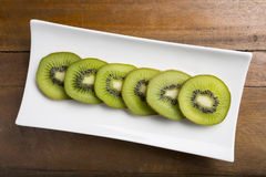 Healthy Fresh cut Kiwi fruit slices on a plate Royalty Free Stock Images
